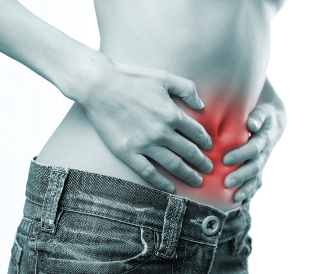 Person grasping their inflamed abdominal area